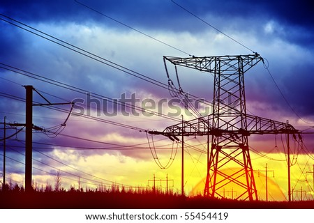 Metal electric pole on a blue sky background - stock photo