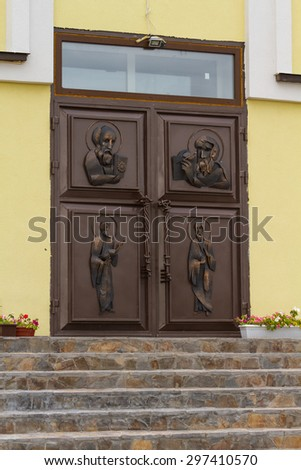 Metal entrance door to the church. - stock photo