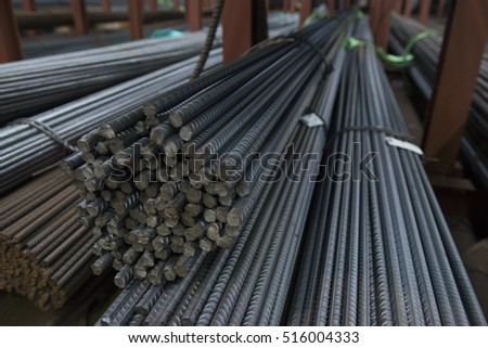 Metal factory, industrial indoor materials (datums on the cards). All metal and iron bars and tubes for selling in this warehouse stock materials.