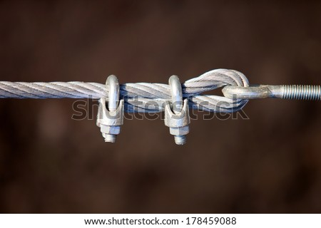 Metal fastening of two cables - stock photo