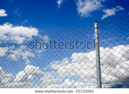 metal fence and blue sky