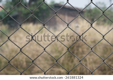 Metal fence and grass background