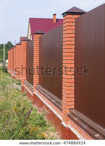 Metal fence with brick pillars cottage