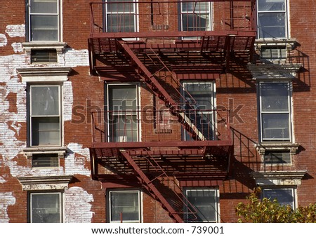 Metal fire escape, Manhattan, New York, America, USA - stock photo