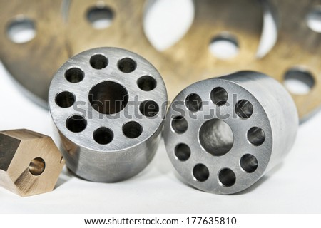 Metal flanges cylinders and brass nuts. CNC milling and lathe industry. - stock photo