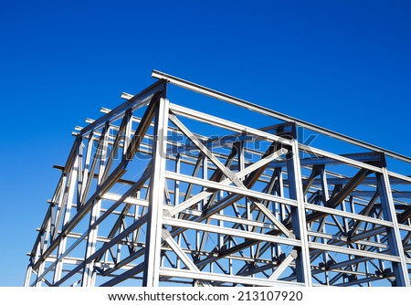 metal frame of the roof against the blue sky - stock photo
