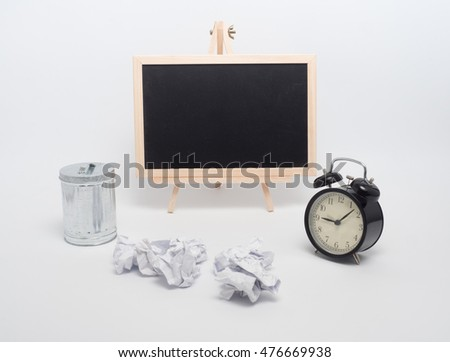 metal garbage bin and paper trash,clock,black board on white background
