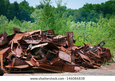 Metal garbage with green trees and grass on background - stock photo