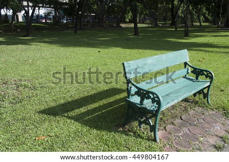 metal garden chair on green grass at sunny day, selective focus