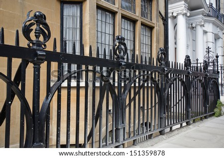 Iron gate on outdoor metal stairs