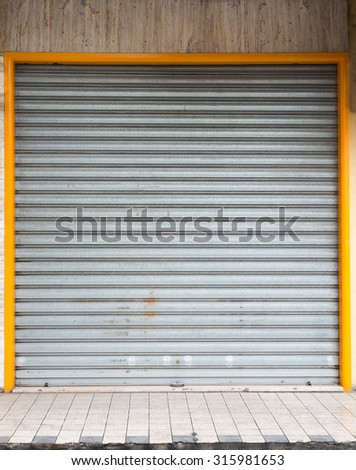 Metal gates with yellow frame in garage
