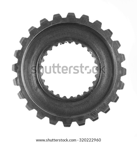 Metal gear on plain background - stock photo