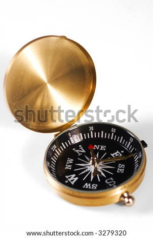 Metal gold-looking compass isolated over white background - stock photo