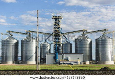 Metal grain silos on a large farm in central Montana, USA.