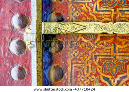 metal grey   morocco in    africa the old wood  facade home and rusty safe padlock  - stock photo