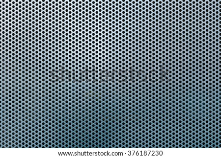 Metal grid abstract pattern and texture in a full frame background with a repeat pattern of holes in a mesh formation - stock photo
