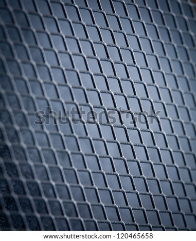metal grid on blue background - stock photo