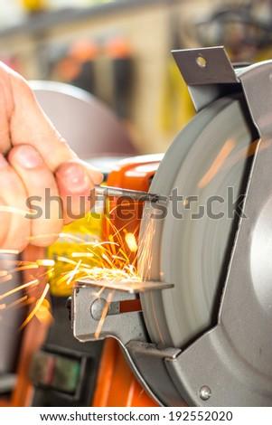 Metal grinder grinding stone - stock photo