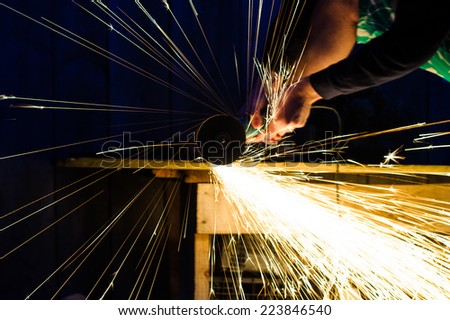 Metal grinding on steel pipe close up - stock photo