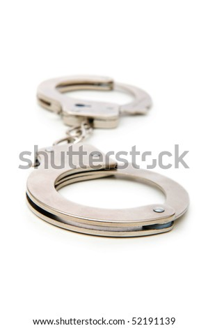 Metal handcuffs isolated on the white background