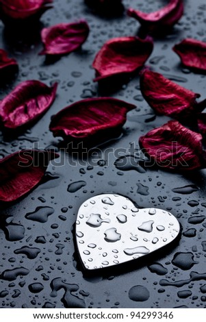metal heart on a black wet background