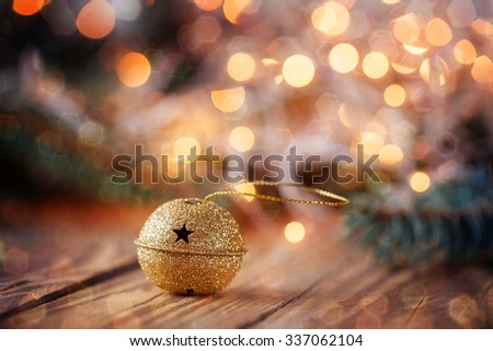 Metal Jingle Bell with snowflake on Wooden Table. Retro Christmas background - stock photo