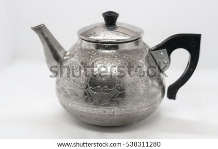 metal kettle with a pattern