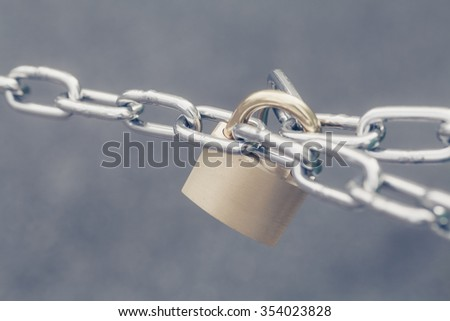 Metal key lock locked with a chain - stock photo
