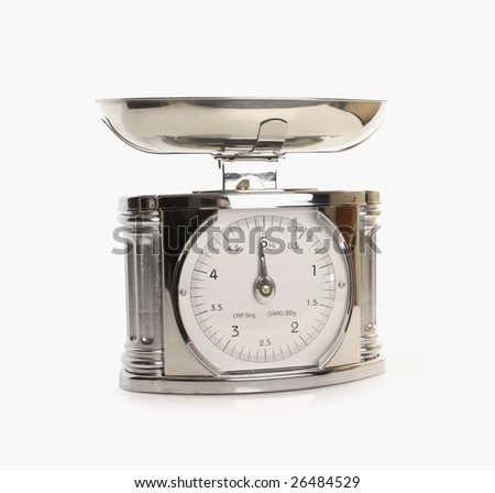 Metal kitchen scales on white background