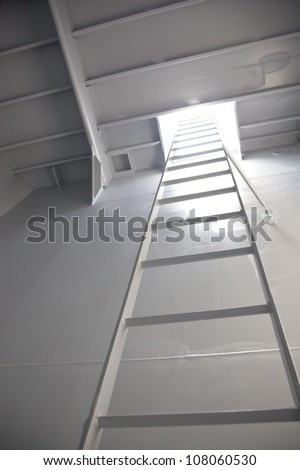 metal ladder inside cement tank - stock photo