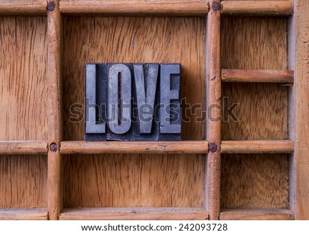 "Metal letterpress in an old typesetter's drawer showing the word ""LOVE"" - stock photo"