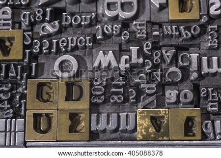 Metal Letterpress Types. A background from many historic typographical letters in black and white with white background. - stock photo
