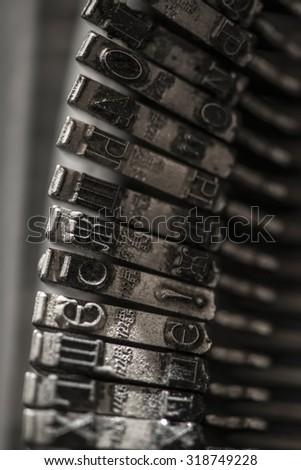 Metal letters on typewriter. Close up macro - stock photo