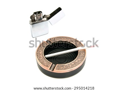 metal lighter and cigarette in the ashtray - stock photo