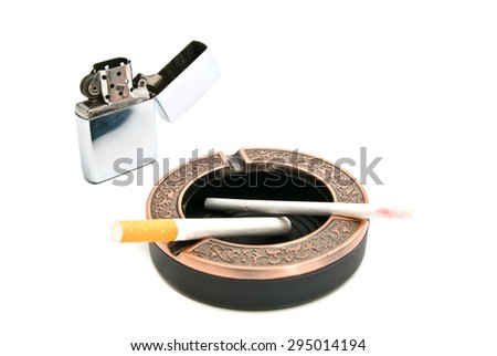 metal lighter and two cigarettes in the ashtray - stock photo