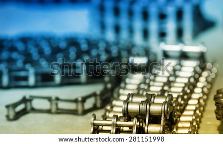 Metal link chains arranged in rows on the table - stock photo
