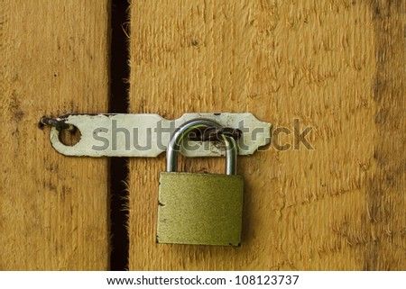 Metal lock on the wooden door closeup