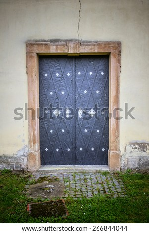 Metal massive door in an ancient fortress Europe.