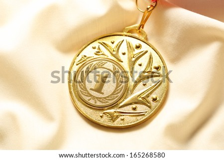Metal medal on silk wrinkled cloth