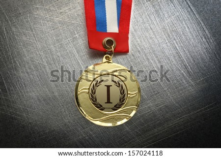 Metal medal with tricolor ribbon on steel scratchy background - stock photo