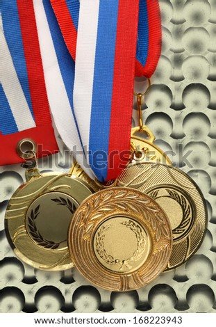 Metal medals on abstract bubble background