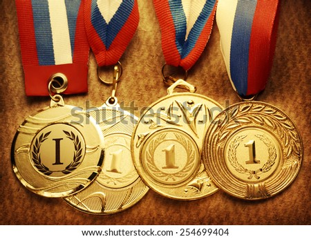 Metal medals with tricolor ribbon in closeup - stock photo