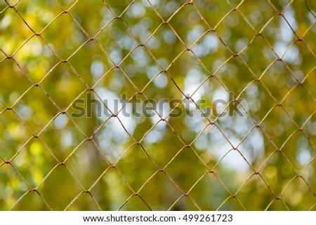 Metal mesh netting on blurred background