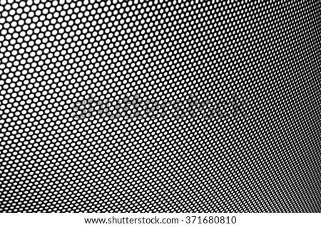 Metal mesh texture (shallow DOF) - stock photo