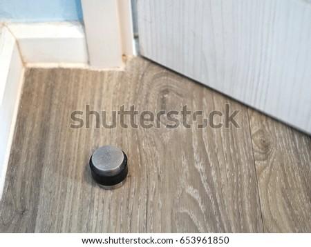 Metal Modern Door Stopper On Floor.