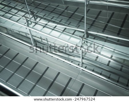 Metal modern ramp for wheelchair or wheel baggage in airport. - stock photo