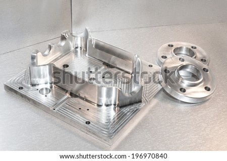 Metal mold/blank and steel flanges. Milling and drilling industry. CNC technology. Mechanical engineering - stock photo