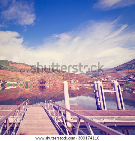 Metal Mooring Line on the River Douro, Portugal, Instagram Effect - stock photo