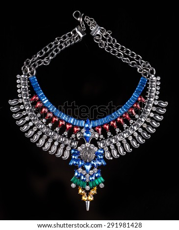 metal necklace with red and blue stones - stock photo