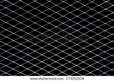 Metal net on black background. - stock photo